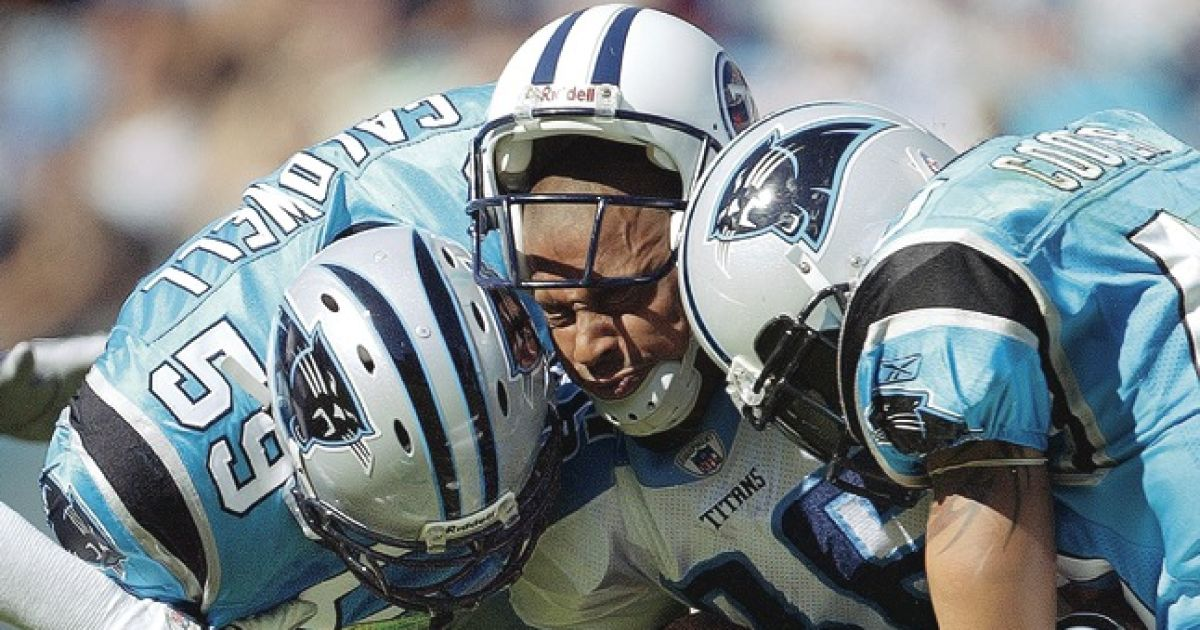 """Panther Prey"" Photo of Tennessee Titans WR Justin McCareins getting sandwiched on a hit by Mike Caldwell (59) and Jarrod Cooper (40) of Carolina Panthers during the 3rd Quarter of their matchup 10/19/03. Credit: Bill Frakes SetNumber: X69478 TK3"